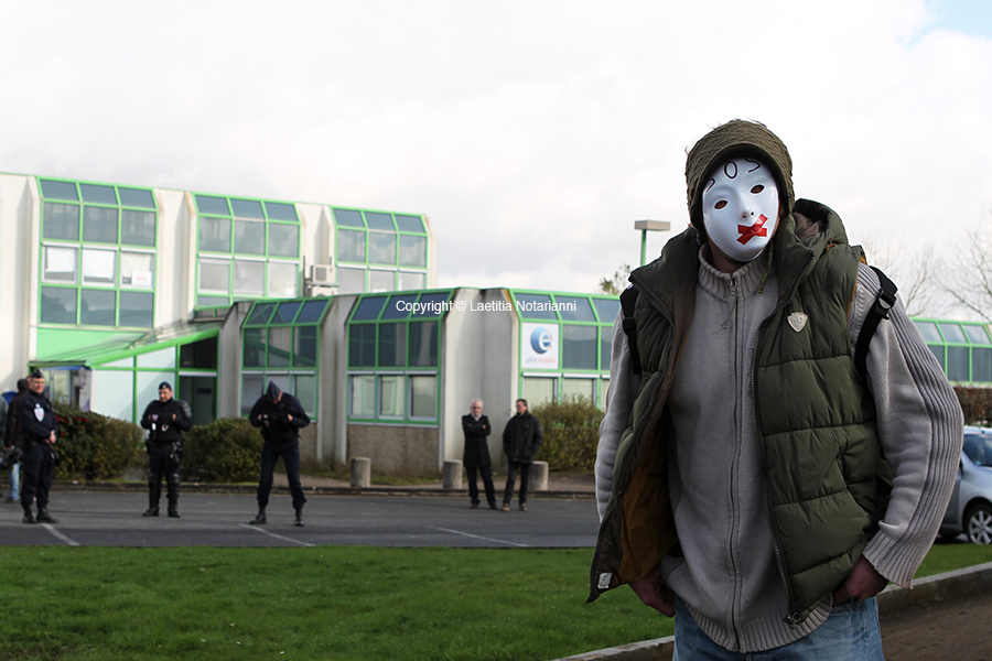 An unemployed man takes part in a gathering, on February 14, 2013, to pay homage to an unemployed man who died the day before setting himself on fire outside the state employment agency in Nantes, western France. Photo by Laetitia Notarianni