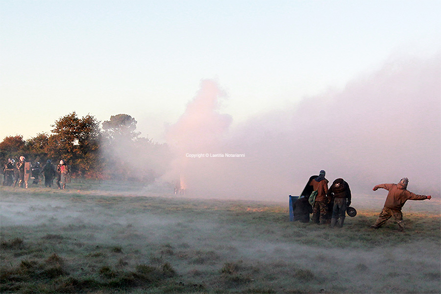 Activists face French gendarmes during an important evacuation operation of houses squatted by opponents against a project to build an international airport, on October 30, 2012 in Notre-Dame-des-Landes, western France. The project was signed in 2010 and the international airport is supposed to open in 2017 near the city of Nantes, western France. Photo by Laetitia Notarianni/ABACAPRESS.COM