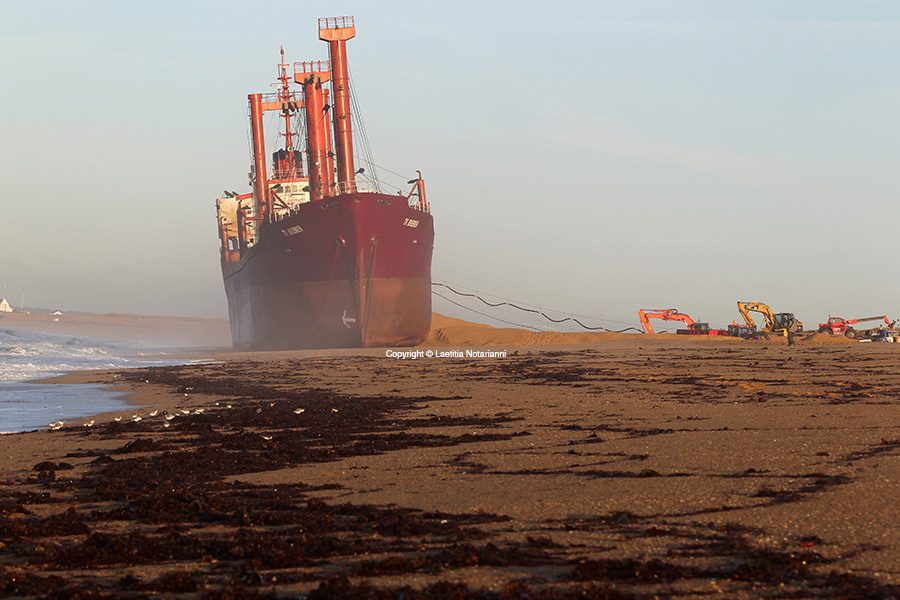 The TK Bremen cargo ship ran aground, spilling oil off the coast of France's northwestern region of Brittany and lies stranted on Kerminihy beach in Erdeven, France, on December 16, 2011. Photo by Laetitia Notarianni/ABACAPRESS.COM