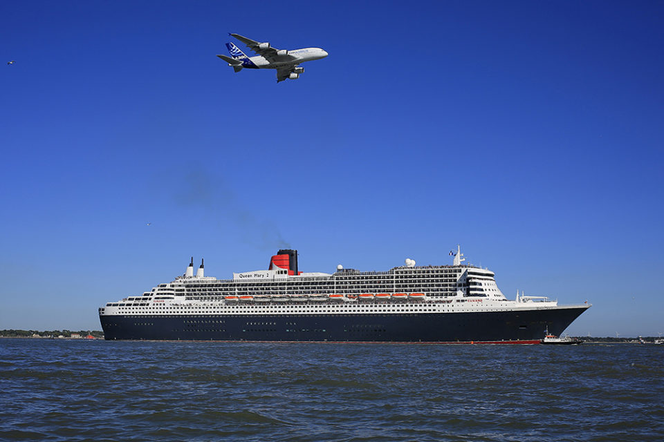 "British cruise ship Queen Mary 2 takes the start of ""The Bridge 2017"" transatlantic race on June 25, 2017 from the French western port city of Saint-Nazaire."